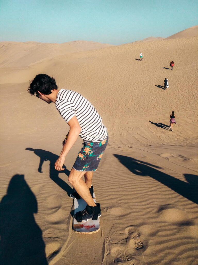 Huacachina sandboarding standing
